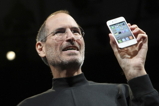 Apple CEO Steve Jobs poses with the new iPhone 4 during the Apple Worldwide Developers Conference in San Francisco, California